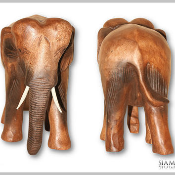 Elephant figure made of wood with hanging trunk