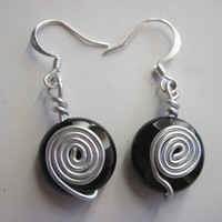 Black earrings, Onyx disk and wire wrapped spiral on silver plated hooks under 15 gift for her by RobertaValle