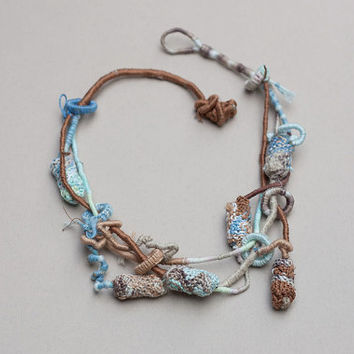 Fiber art necklace, statement hand wrapped jewelry with knitted and bamboo beads, light blue brown, OOAK