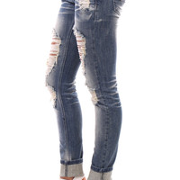 Super Distressed Skinny Jeans