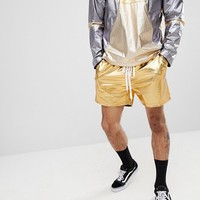 Reclaimed Vintage Inspired Shorts In Gold Metallic at asos.com