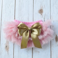 Adorable newborn and baby size pink and gold ruffled tutu skirt with large gold satin bow. Perfect for photo shoot, cake smash 1st birthday parties.