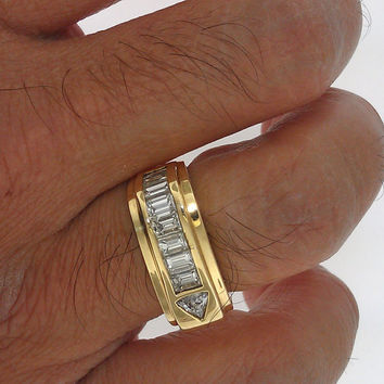 14K yellow gold mens diamond band ring, square shank with 8 baguette diamonds color and 1 trilliant. Ttl dia wgt 1.40 carats
