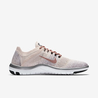 The Nike Free Focus Flyknit 2 Chrome Blush Women's Training Shoe.