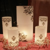 Luminary centerpiece set includes one 13 inch tall lumie, two 8.5 inch lumies, and two 6 inch lumies