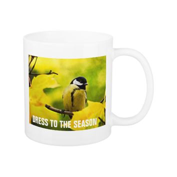 Yellow tomtit in golden autumn coffee mug