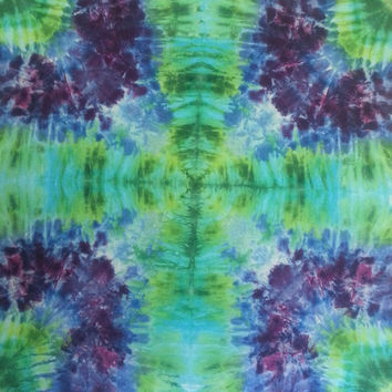 Psychedelic tie dye tapestry in green, blue and purple wall hanging