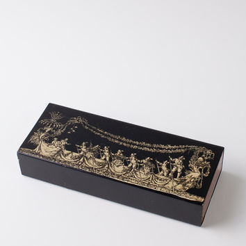 Significant Piero Fornasetti lacquered wood box with metal plate.