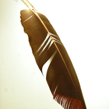 inked and painted feather with wrapped quill and geometric design