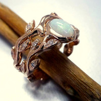 Engagement ring with opal and diamonds.  Leaf engagement ring set