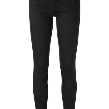 Versus lion head embellished rear pocket skinny trousers