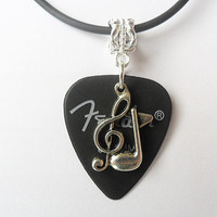 "Guitar pick necklace,black, with treble clef music note charm that is adjustable from 18"" to 20"""