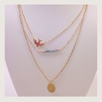 NWOT Gold layer necklace with beads & bird