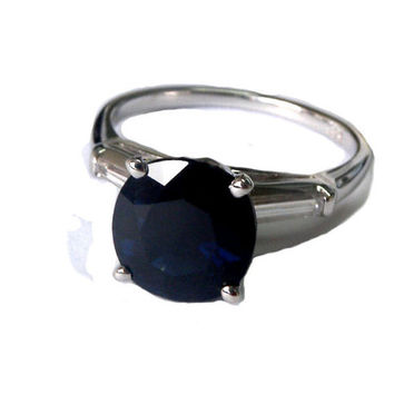 3.03 carat Deep dark Sapphire flanked by 2 taper baguette diamonds Gorgous ring in White Gold