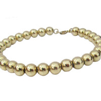 Minimalist bracelet  14K Yellow Gold, 10.4 Grams, 6 mm round golden balls with a 14K gold chain inside