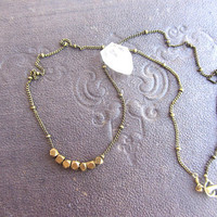 Tiny gold brass choker necklace with faceted brass beads.