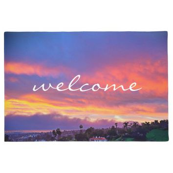 """Welcome"" pink blue & yellow sunrise photo doormat"