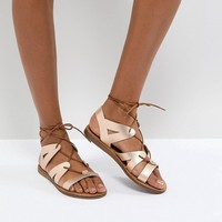Office Saffy Rose Gold Leather Gladiator Lace Up Sandals at asos.com