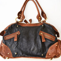 Large brown and black vintage leather bag