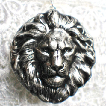 Silver locket with silver lion mounted on front cover with sterling silver plated chain.