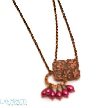 Copper flourish pendant with red teardrop pearls asymmetrical necklace