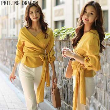 PEILING DRAGON 2017 women korean fashion gold bow lace up wrap wrinkle tops v-neck flare sleeve long sleeve shirt blouse T308