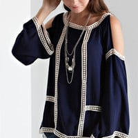 Solid cold shoulder peasant blouse with ladder lace accent.