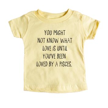 You might not know what love is until you've been loved by a Pisces. Baby Tee