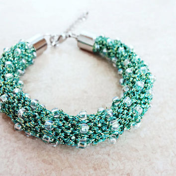 Knitted bracelet in green tone lurex yarn and cristal color Toho beads, fiber design, textile design, beadwork, gift ideas, seed beads
