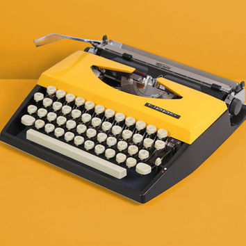 1968 Mod Adler Tippa Typewriter. Restored and fully working. Black and yellow. Slim and portable. With Case. Modified.