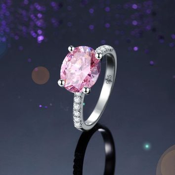 Luxurious Fancy pink 4 carat solitaire oval cut ring