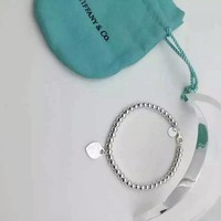 Tiffany & Co. Double Sided Silver Heart bracelet