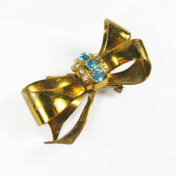 Vintage Coro Brooch Bow with Turquoise Rhinestones in Gold Tone - Broche.