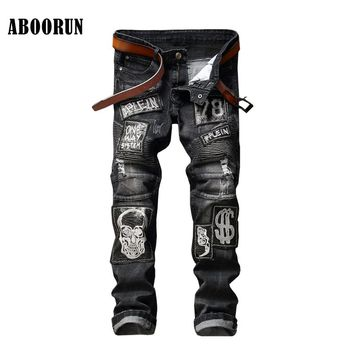 Punk Style Mens Skull Embroidery Jeans with Patchwork Black Distress Ripped Hole Denim Pants