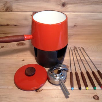 Michael Lax designed Copco fondue pot with teak handle/lid and cast iron heating stand, includes six fondue forks