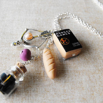 The Hunger Games inspired necklace- Miniature book, bow, coal, bread, nightlock berry