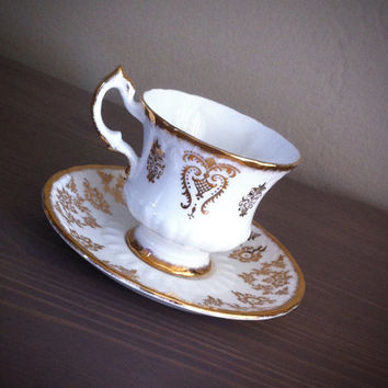 Gold and white vintage paragon tea cup and saucer, English bone china tea set, gold gilt teacup, wedding bridal gift