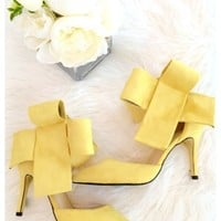 Bradshaw bow heels - Yellow bow high heels with above the ankle closure.