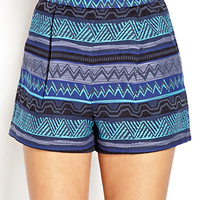 Voyager High-Waisted Pleated Shorts