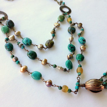 Triple strand Turquoise and antiqued brass necklace with Roman glass, pearls and african trade beads.