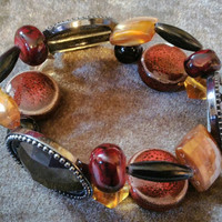 Extraordinary double beaded bracelet in browns, reds, ambers, & black beads..