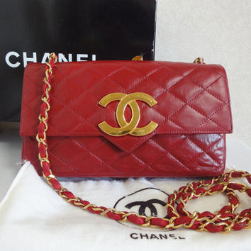 80's vintage CHANEL red lambskin chain shoulder bag with golden large CC closure and beak flap tip. Classic 2.55 bag. Rare masterpiece