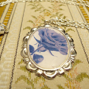Blue rose pendant necklace with a decorative by NellinShoppi