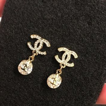 DCCKG7J Gold CC Earrings