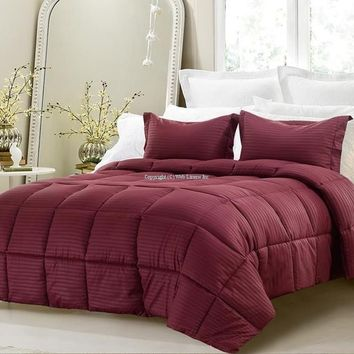 3PC REVERSIBLE SOLID/ EMBOSS STRIPED COMFORTER SET- OVERSIZED AND OVERFILLED ( 2 BEDDING LOOKS IN 1) - WINE