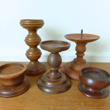 Five large turned wood candle holders, pillar candle holders