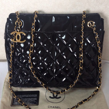 Vintage CHANEL patent enamel quilted black leather large shoulder tote bag with large golden CC charm and  chains.