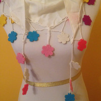 White triangular scarf with colorful accents