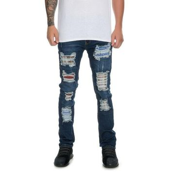 Grant Distressed Patch Skinny Jeans