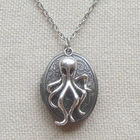Antiqued silver locket necklace with octopus